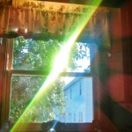 Green wavelength light emerges from a prism.